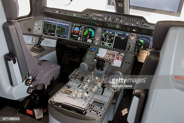 Airbus exhibition stand showing fullscale A350 XWB cockpit mockup at the Farnborough Air Show England The A350 XWB is the only allnew aircraft in the...