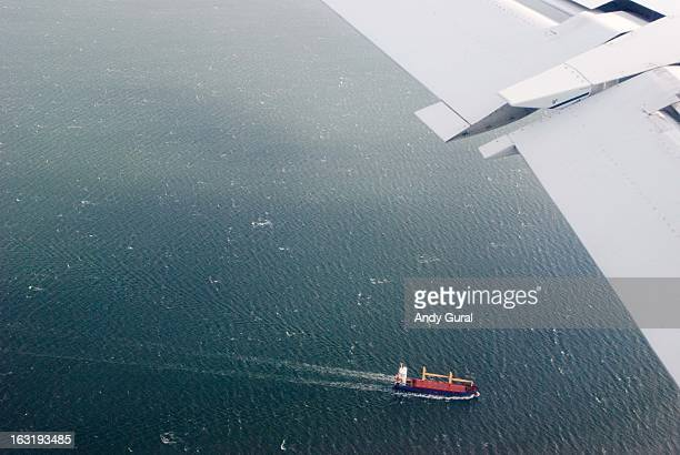 CONTENT] Airbus fixed wing aircraft under 9k feet overflying a full cargo ship in calm seas over the Firth of Forth in Scotland RAW file available