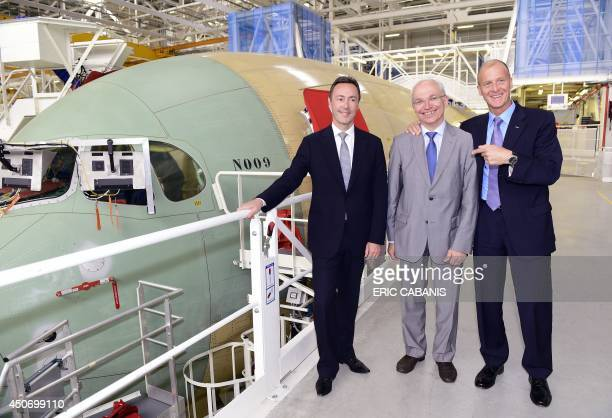 Airbus Group CEO, German Tom Enders, flanked by Airbus CEO, French Fabrice Bregier and A350 Airbus plane project manager Didier Evrard , gestures in...