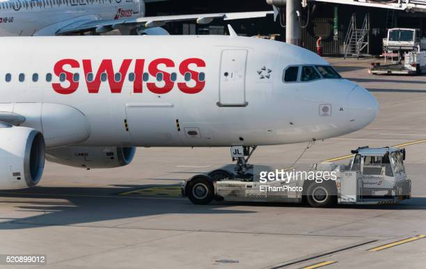 airbus of swiss international air lines pushed by aircraft tug - a320 stock pictures, royalty-free photos & images