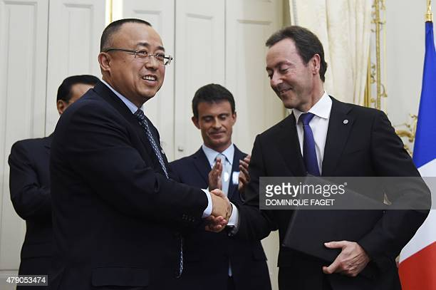 Airbus' President Fabrice Bregier shakes hands with CAS president LI Hai during an agreement signing ceremony in front of French Prime minister...