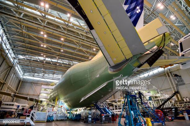 TOPSHOT Airbus technicians work on the assembly line of the Airbus Beluga XL large transport aircraft on March 20 2018 in Blagnac near Toulouse...