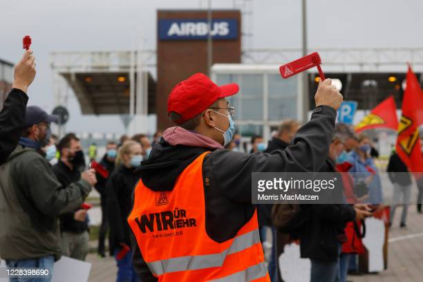 Airbus workers gather in front of the Airbus Finkenwerder plant to protest against pending job cuts during the coronavirus pandemic on September 8,...