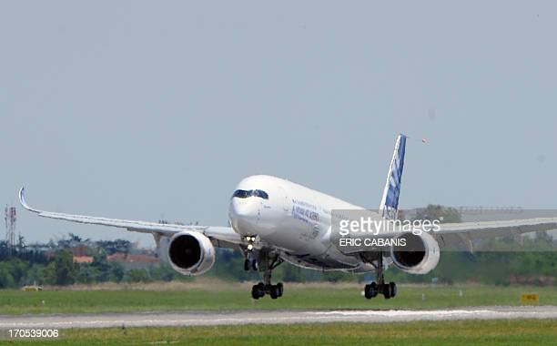 Airbus's nextgeneration A350 plane lands on the airstrip of ToulouseBlagnac airport southwestern France at the end of its first test flight on June...