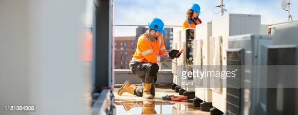 aircon engineers - installing stock pictures, royalty-free photos & images