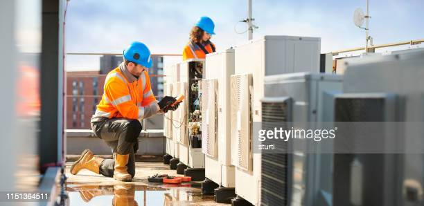 aircon engineers - electrician stock pictures, royalty-free photos & images