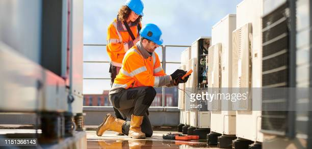 aircon engineers - electricity stock pictures, royalty-free photos & images