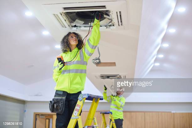 airconditioning installation in a gym - electrical equipment stock pictures, royalty-free photos & images