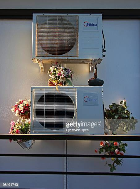 Airconditioning system decorated with artificial flowers in a backyard on July 16 2009 in Rhodes Greece Rhodes is the largest of the Greek Dodecanes...