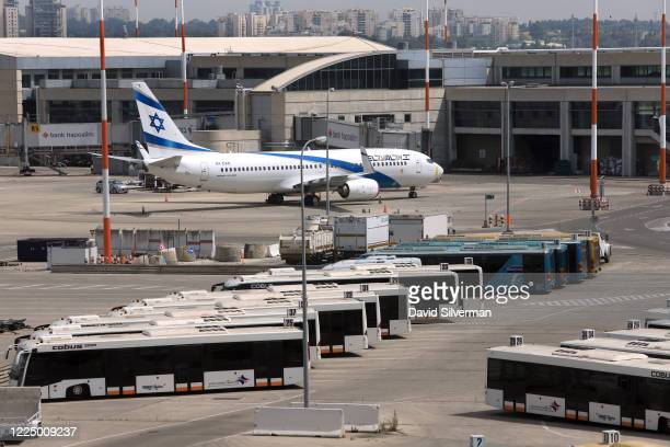 Aircraft and passenger buses are parked at Ben Gurion Airport on May 14, 2020 near Tel Aviv, Israel. Authorities are preparing for the full reopening...