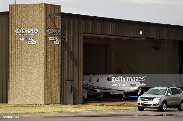 Aircraft are moved from the partially collapsed roof of the Tempus Aircraft section of a hangar at Centennial Airport that was damaged as storms...