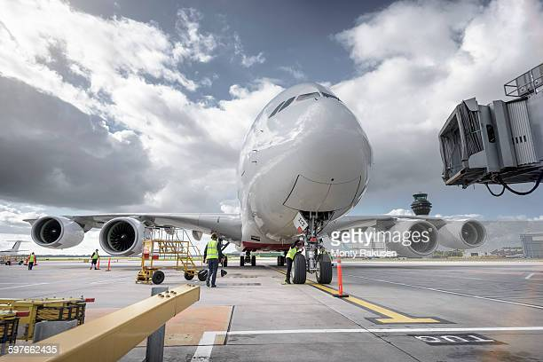 a380 aircraft arriving at airport - passenger boarding bridge stock pictures, royalty-free photos & images