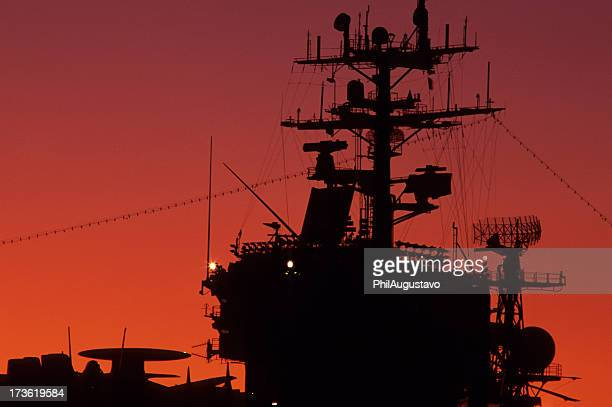 aircraft carrier at sunset - navy stock pictures, royalty-free photos & images
