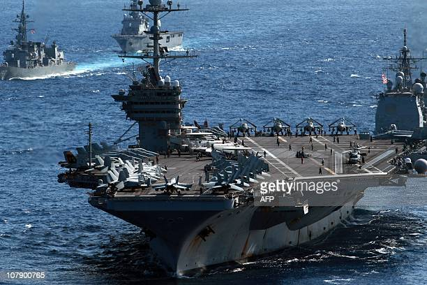 US aircraft carrier USS George Washington sails among US and Japanese warships during the Keen Sword USJapan military exercises in the Pacific Ocean...