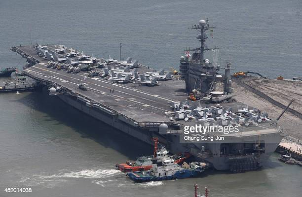 US aircraft carrier USS George Washington sits at anchor in Busan port on July 11 2014 in Busan South Korea The US Navy's aircraft carrier USS George...