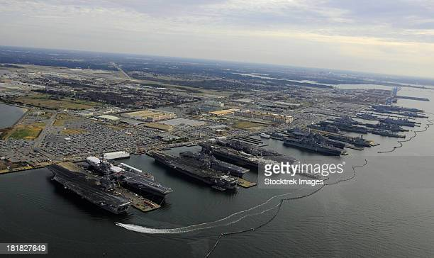 aircraft carriers in port at naval station norfolk, virginia. - norfolk virginia stock photos and pictures