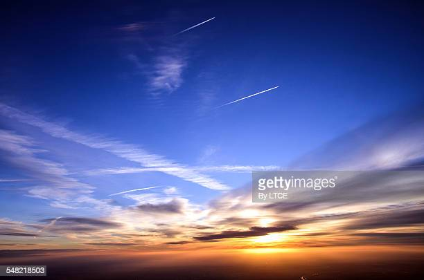 Aircraft contrails in the sky during sunrise