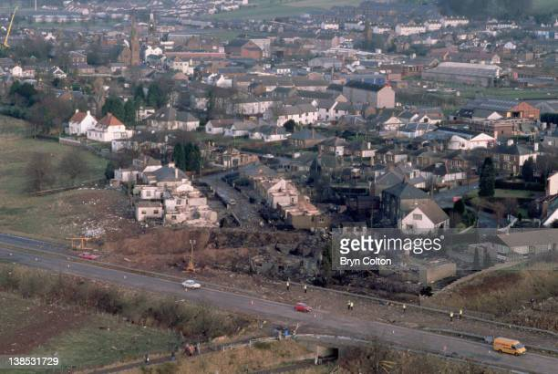 Aircraft debris and destroyed houses in Sherwood Crescent Lockerbie are seen from the air as traffic passes along the A74 main road following the...