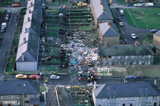 Aircraft debris and destroyed houses in the village of Lockerbie are seen from the air following the midair explosion of Pan Ams flight 103 'Clipper...