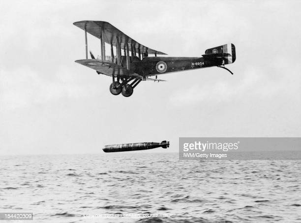 Aircraft During The First World War, Sopwith Cuckoo dropping a torpedo during trials at the Torpedo Aeroplane School, East Fortune, 24 - 26 July...