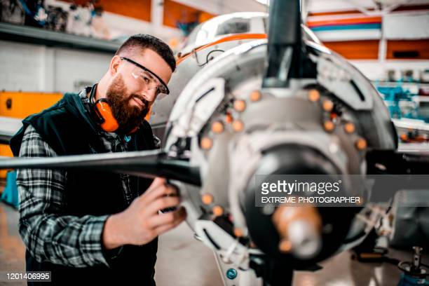aircraft engineer repairing a small front-engine airplane disassembled in a hangar - aerospace industry stock pictures, royalty-free photos & images