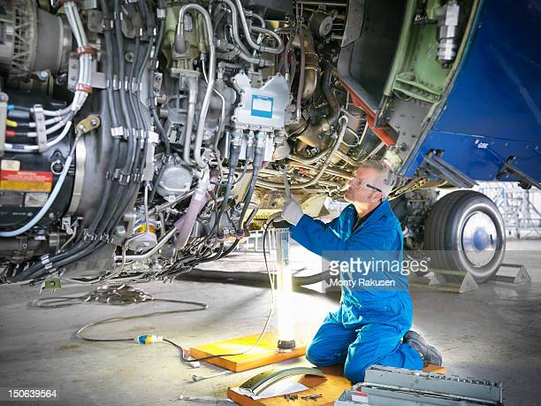 Aircraft engineer working on 737 engine in hangar