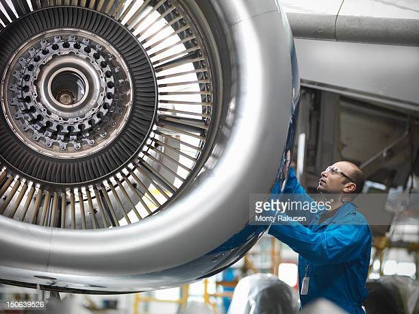 aircraft engineer working on 737 jet engine in airport - aircraft stock photos and pictures