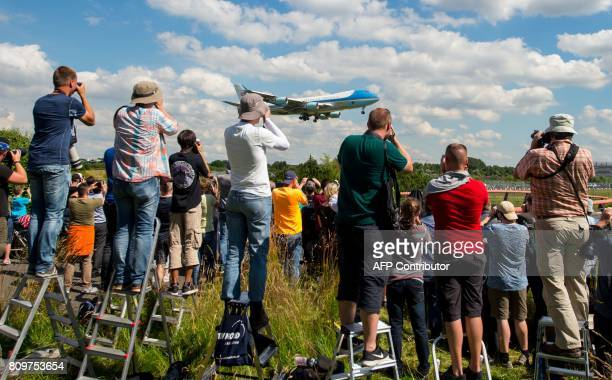 TOPSHOT Aircraft enthusiasts photograph the landing of US President Donald Trump and US First Lady Melania Trump in Air Force One at the airport in...