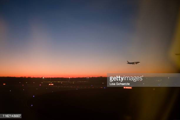 aircraft flying at the sunrise sky - frankfurt international airport stock pictures, royalty-free photos & images