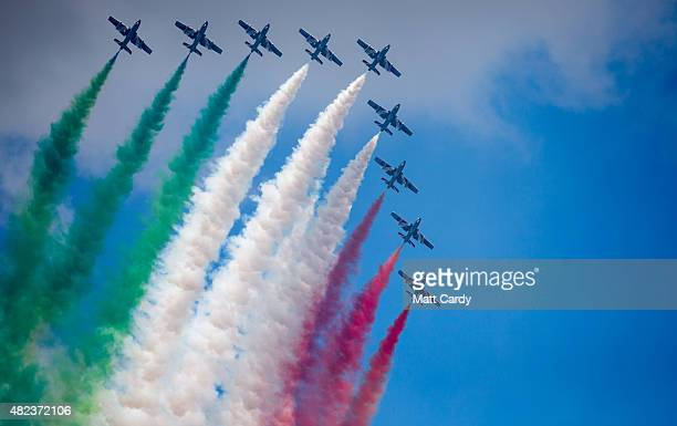 Aircraft fom the Italian Air Force's Frecce Tricolori fly at the 2015 Culdrose Air Day at RNAS Culdrose near Helston on July 30 2015 in Cornwall...