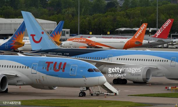 Aircraft grounded due to the COVID-19 pandemic, including planes operated by TUI, EasyJet and Jet2, are pictured on the apron at Manchester Airport...