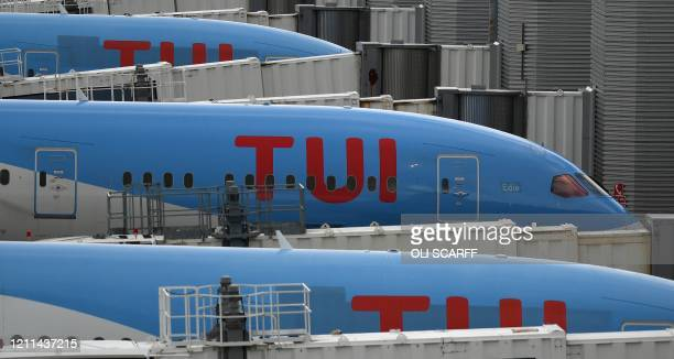 Aircraft grounded due to the COVID19 pandemic including planes operated by TUI are pictured on the apron at Manchester Airport in Manchester north...
