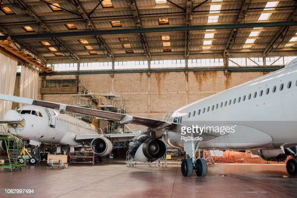 aircraft hangar - fuselage stock photos and pictures