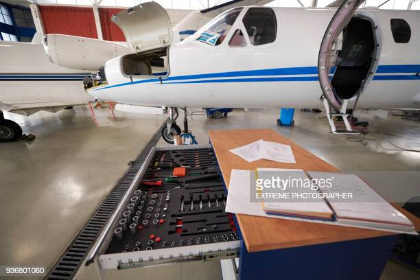 aircraft in the hangar - handbook stock photos and pictures
