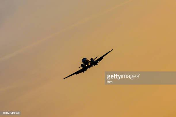 aircraft in the sky at sunset (schönefeld, brandenburg/ germany) - the slants stock pictures, royalty-free photos & images