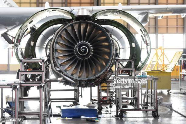aircraft jet engine maintenance in airplane hangar - aerospace industry stock pictures, royalty-free photos & images