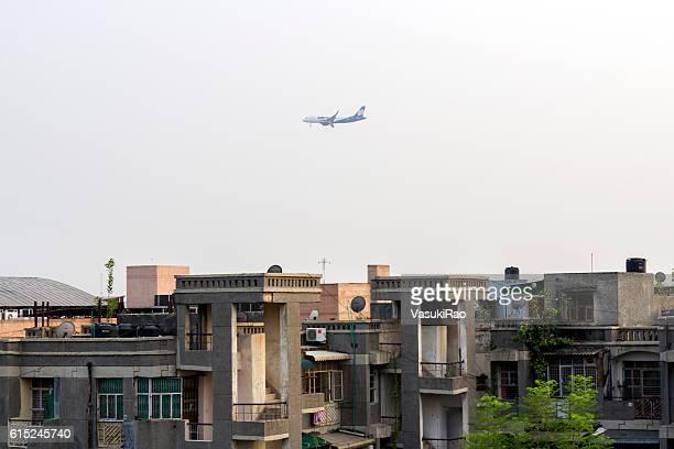 aircraft landing at delhi airport, india - delhi airport stock photos and pictures