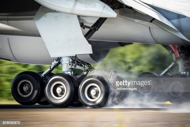 aircraft landing gear - aircraft stock photos and pictures
