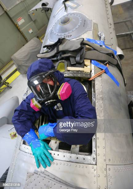 A aircraft mechanic climbs out of the fuel tank of an A10 Thunderbolt Warthog on December 20 2017 at Hill Air Force base in Ogden Utah Hill Air Force...
