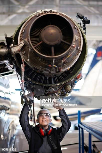 Aircraft mechanic in the hangar