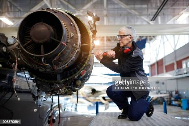 aircraft mechanic in the hangar - aircraft stock photos and pictures