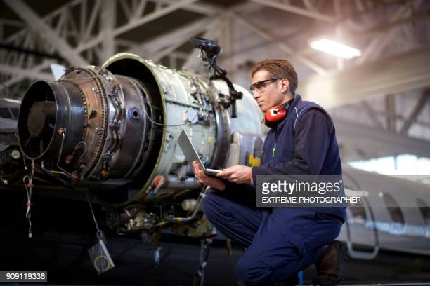 aircraft mechanic in the hangar - jet engine stock photos and pictures