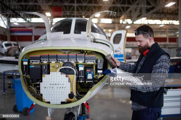 aircraft mechanic in the hangar - instructions stock pictures, royalty-free photos & images