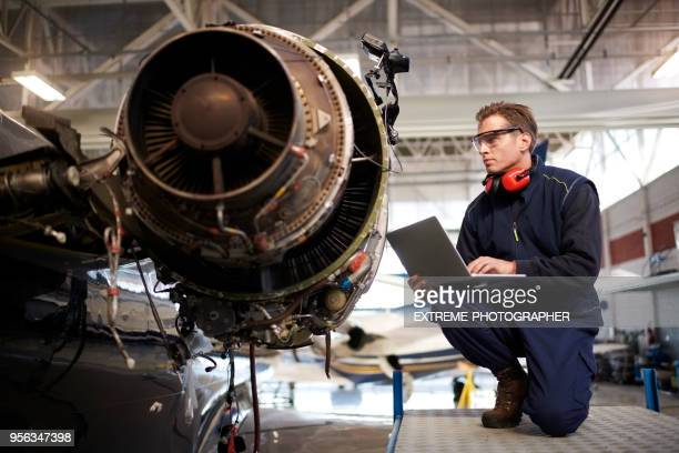 aircraft mechanic in the hangar - aerospace industry stock pictures, royalty-free photos & images