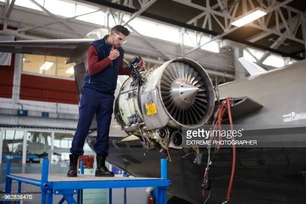 aircraft mechanic in the hangar - air vehicle stock pictures, royalty-free photos & images