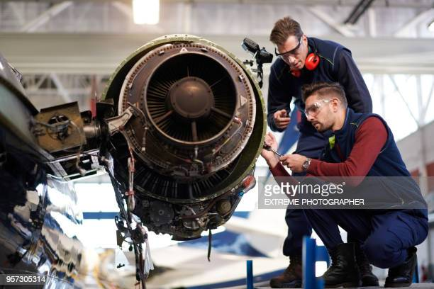 aircraft mechanics in the hangar - aircraft stock photos and pictures