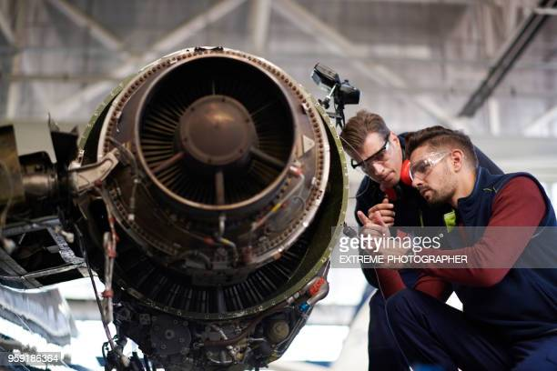 aircraft mechanics in the hangar - jet engine stock photos and pictures