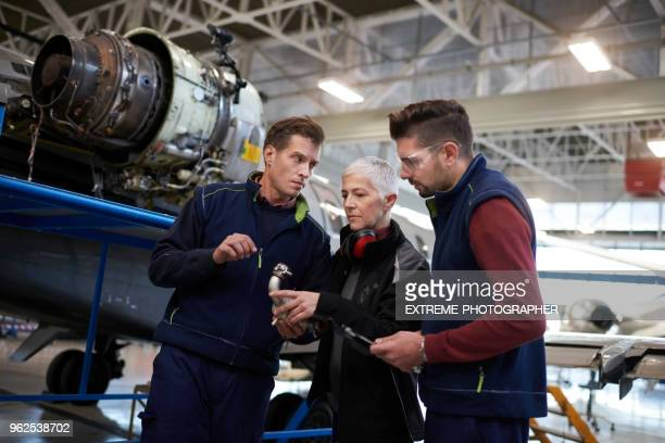 Aircraft mechanics in the hangar