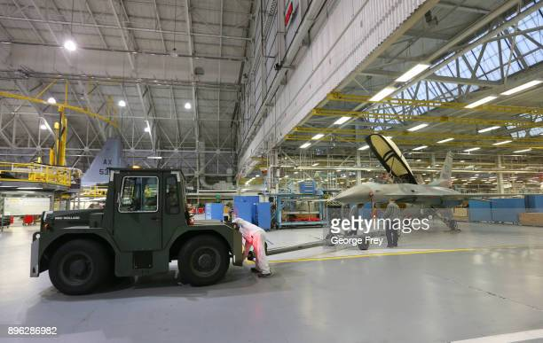 Aircraft mechanics tow an F16 Falcon into place on December 20 2017 at Hill Air Force base in Ogden Utah Hill Air Force Base has one of the largest...