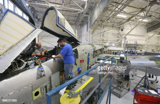 Aircraft mechanics work in the cockpit of an A10 Thunderbolt Warthog on December 20 2017 at Hill Air Force base in Ogden Utah Hill Air Force Base has...